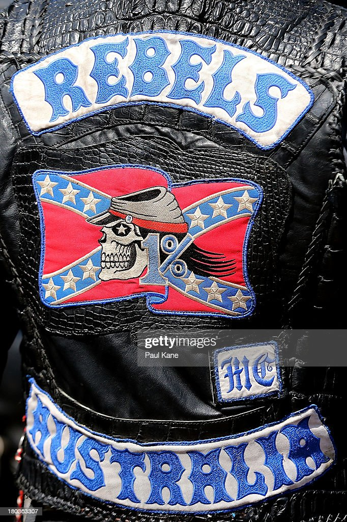 The Rebels motorcycle club insignia is displayed on the back of a member at the Tammin roadhouse on September 12, 2013 in Perth, Australia. An estimated 1000 Rebels from chapters all over Australia gather for the road trip across the country to Perth.