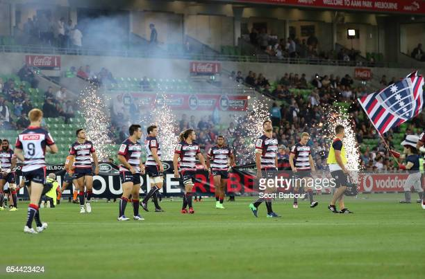 The Rebels run onto the field during the round four Super Rugby match between the Rebels and the Chiefs at AAMI Park on March 17 2017 in Melbourne...