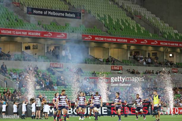 The Rebels run onto the field in front of an empty stand during the round four Super Rugby match between the Rebels and the Chiefs at AAMI Park on...