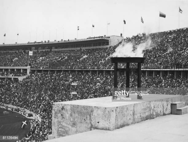 The recentlylit Olympic flame at the opening ceremony of the Berlin Olympics 1st August 1936
