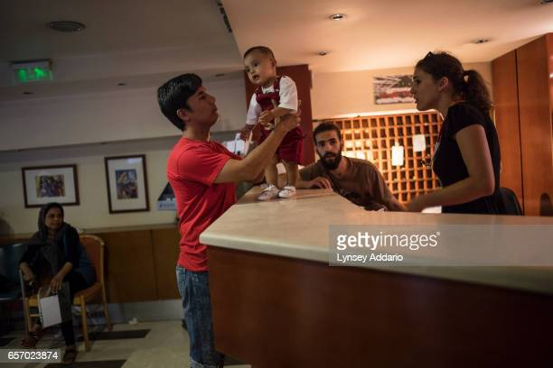 The reception desk at the City Plaza business hotel is manned by a rotating staff of international volunteers who help refugees from Syria Iraq...