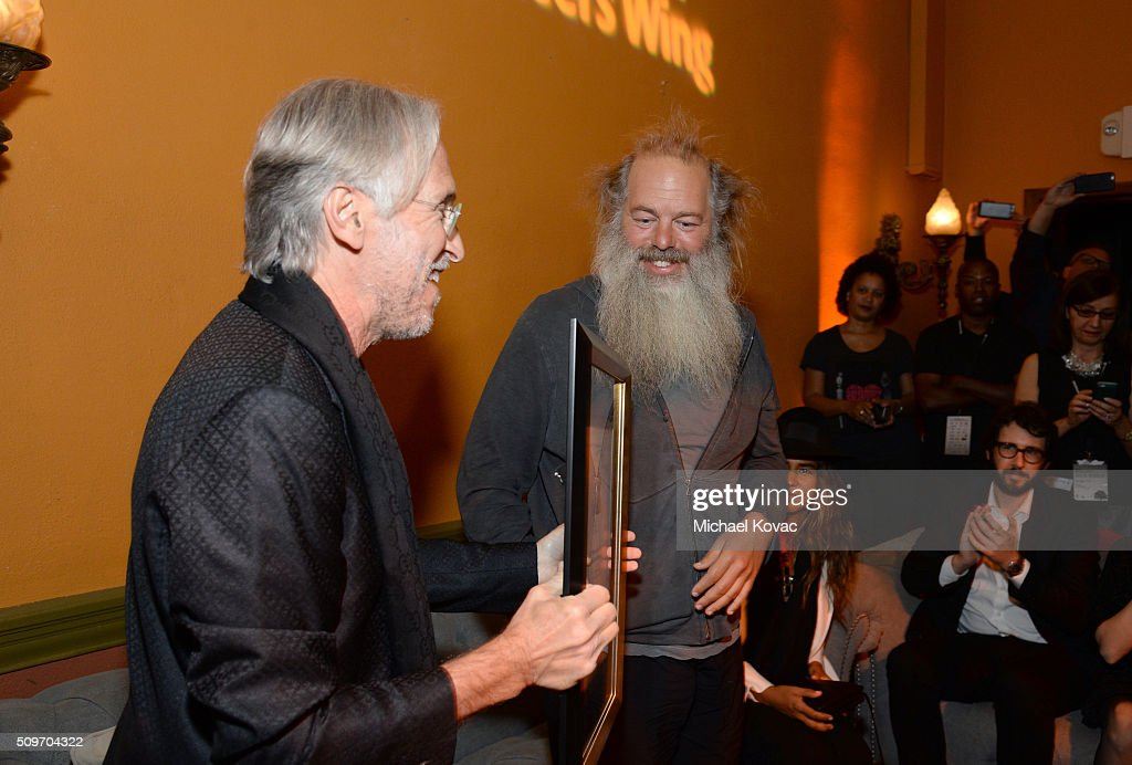 The Recording Academy CEO and President Neil Portnow presents the The Recording Academy's President's Merit Award to honoree Rick Rubin during the PE...