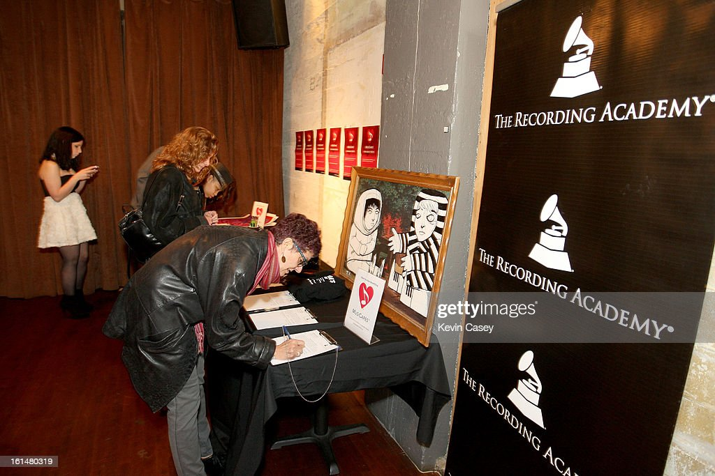 The Recording Academy members and guests sign up for the various items in the silent auction at Spitfire on February 10, 2013 in Seattle, Washington.