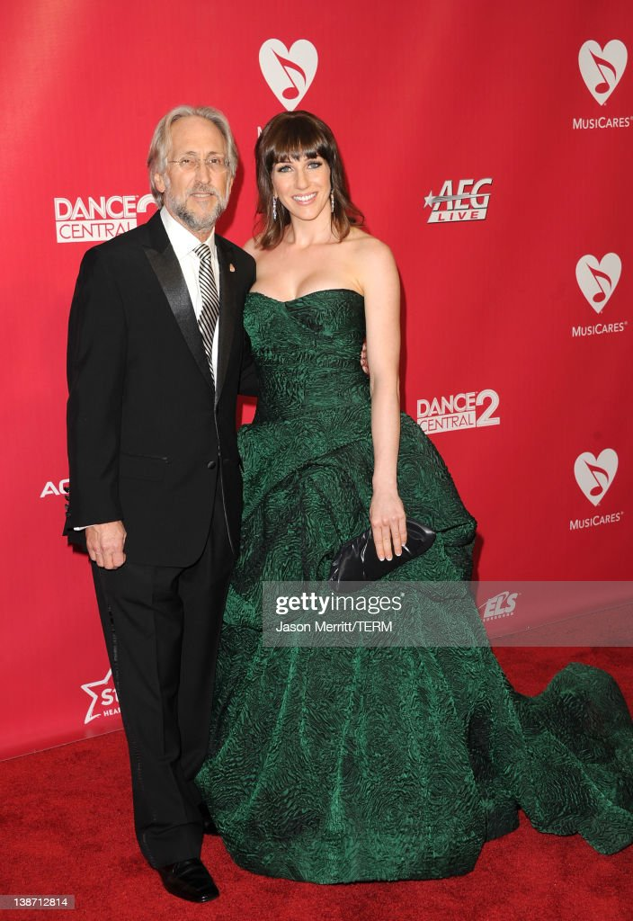 The Recording Academy President and CEO <a gi-track='captionPersonalityLinkClicked' href=/galleries/search?phrase=Neil+Portnow&family=editorial&specificpeople=208909 ng-click='$event.stopPropagation()'>Neil Portnow</a> (L) and Rachel Agosto arrive at the 2012 MusiCares Person of the Year Tribute To Paul McCartney held at the Los Angeles Convention Center on February 10, 2012 in Los Angeles, California.
