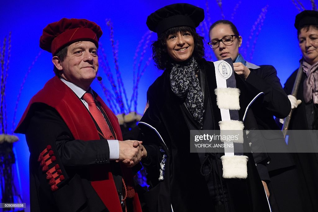 The Rector of the KU Leuven university Rik Torfs (L) shakes hands with French microbiologist Emmanuelle Charpentier during a ceremony for the Doctors Honoris Causa honorary degrees at the KU Leuven university, on February 10, 2016. / AFP / BELGA / YORICK JANSENS / Belgium OUT
