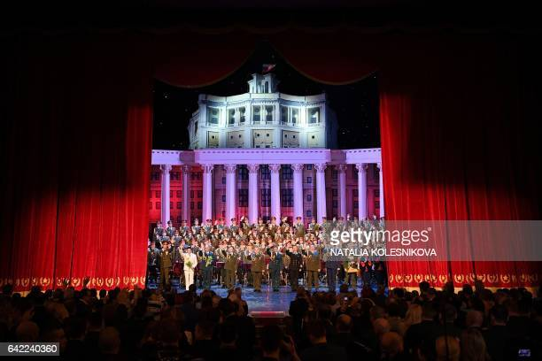 The Red Army Choir members take a bow during the curtain call after their first performance since many of its members were killed in a plane crash in...