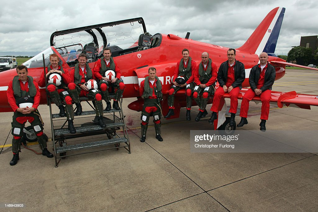 The Red Arrows 2012 team pose on a Hawk jet for a team photograph at RAF Scampton. (L-R) Squadron Leader Martin Higgins, Flight Lieutenant Martin Pert, Squadron Leader Jim Turner, Flight Lieutenant Michael Child, Flight Lieutenant Chris Lyndon-Smith, Flight Lieutenant James McMillan, Flight Lieutenant Ben Plank, Flight Lieutenant <a gi-track='captionPersonalityLinkClicked' href=/galleries/search?phrase=Dave+Davies&family=editorial&specificpeople=899849 ng-click='$event.stopPropagation()'>Dave Davies</a> and Squadron Leader Mike Ling on June 22, 2012 in Scampton, England. The famous Royal Air Force Red Arrows are perfecting their routine for a fly past next week when the Olympic torch arrives in Norfolk and also for an audience of millions during the opening ceremony of the London 2012 Olympics.