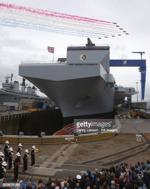The Red Arrows fly over as Queen Elizabeth II officially names Royal Navy's new aircraft carrier HMS Queen Elizabeth during a visit to Rosyth...