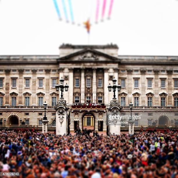 WINDSOR England JUNE 13 The Red Arrows fly over Buckingham Palace as the Royals look out from the balcony during Trooping the Colour Ceremony on June...