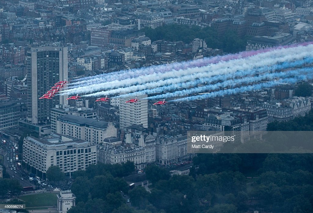The Red Arrows fly over central London as part of Her Majesty The Queen's Birthday Flypast during Trooping the Colour on June 14, 2014 in London, England.