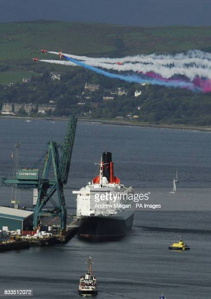 The Red Arrows fly past the QE2 as its sits in the docks at Ocean Terminal in Greenock the ship is in Greenock for its 40th Birthday