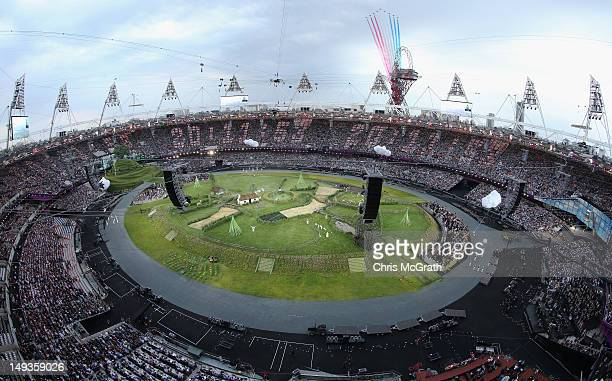 The Red Arrows perform a flyover prior to the Opening Ceremony of the London 2012 Olympic Games at the Olympic Stadium on July 27 2012 in London...
