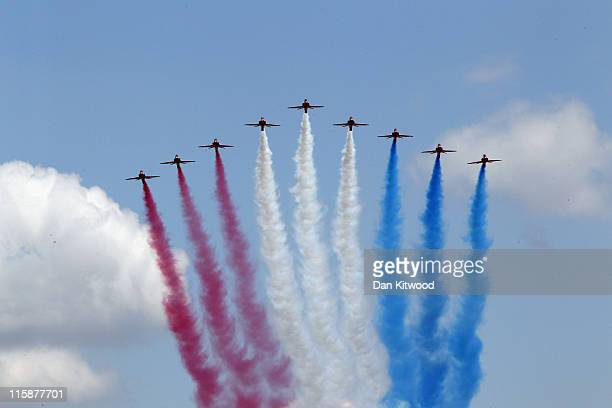 The Red Arrows perform a flypast over Buckingham Palace after the Trooping the Colour parade on June 11 2011 in London England The ceremony of...
