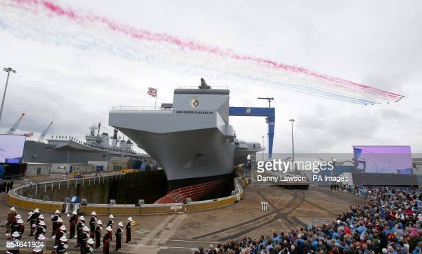 The Red Arrows perform a flypast over HMS Queen Elizabeth in Rosyth Dockyard Fife where the Queen will formally name the Royal Navy's biggest ever...