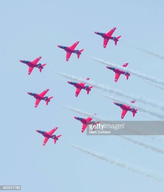 The Red Arrows performing an aerobatic didplay during their 50th Display Season at The Royal International Air Tattoo at RAF Fairford on July 11 2014...