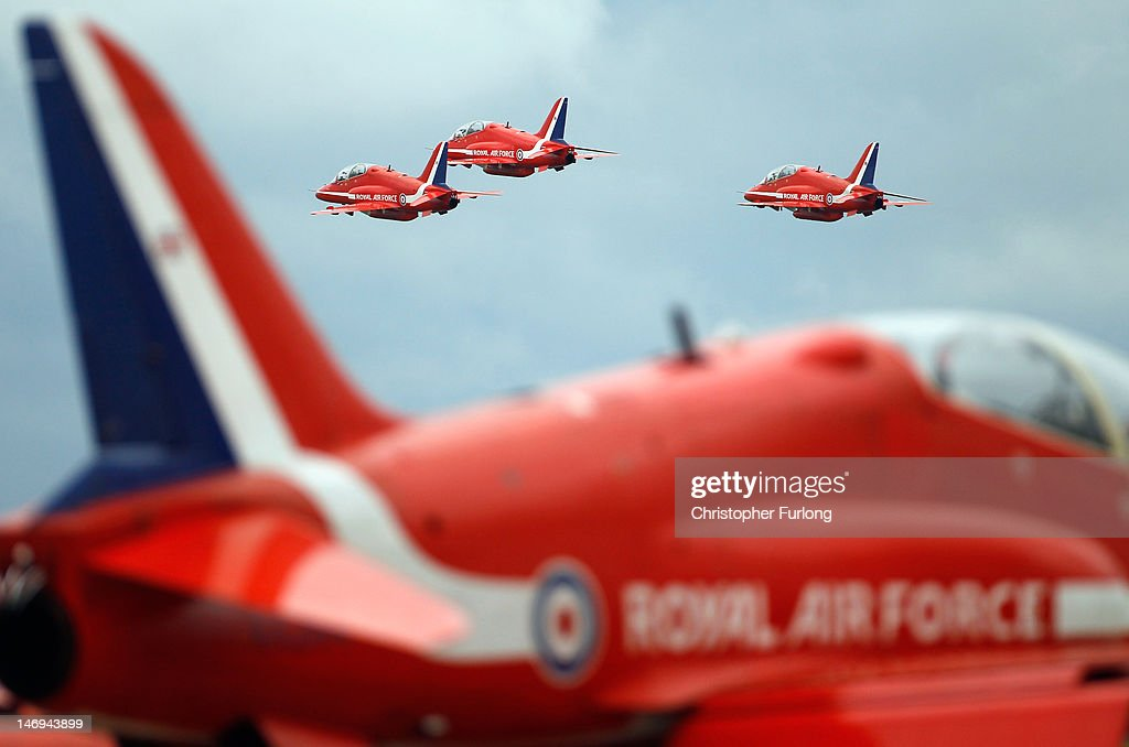 The Red Arrows practise their 2012 air display at RAF Scampton on June 22, 2012 in Scampton, England. The famous Royal Air Force Red Arrows are perfecting their routine for a fly past next week when the Olympic torch arrives in Norfolk and also for an audience of millions during the opening ceremony of the London 2012 Olympics.