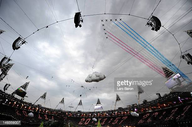 The Red Arrows the Royal Air Force aerobatic team fly over the stadium during the Opening Ceremony of the London 2012 Olympic Games at the Olympic...