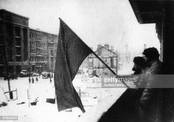 The red banner of the Soviet Army is hoisted up in a recaptured part of Stalingrad as the German Sixth Army is beaten 1943