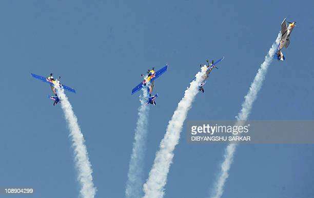 The Red Bull aerobatics team fly in formation on the eve of the Aero India 2011 exposition at the Yelhanka Air Force station in Bangalore on February...