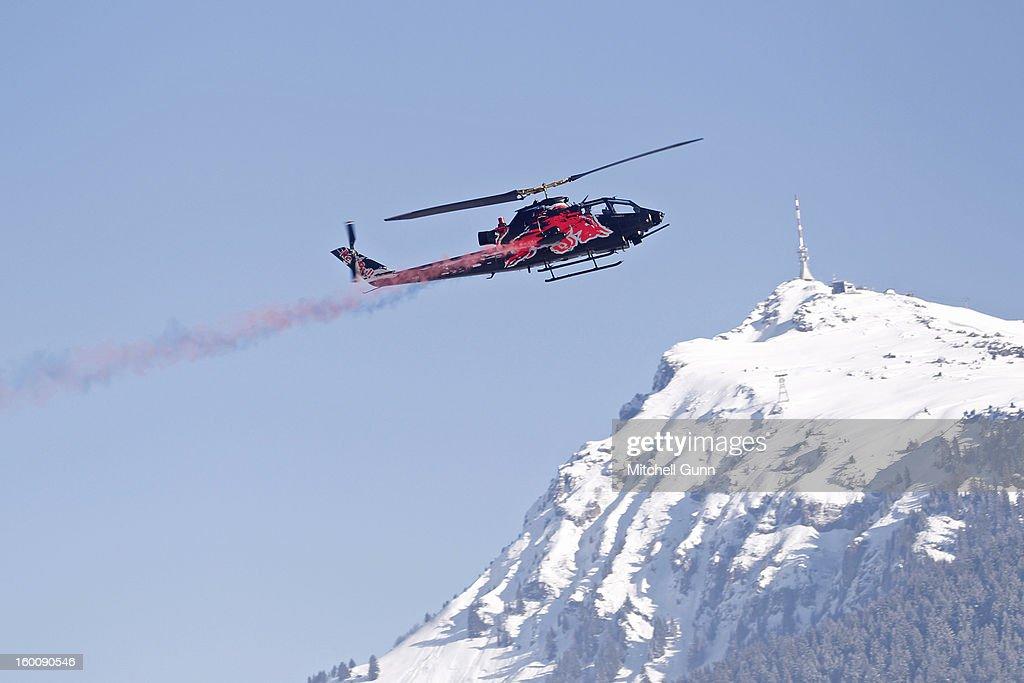 The Red Bull Air Display Team perform before the Audi FIS Alpine Ski World Cup Downhill on January 26, 2013 in Kitzbuhel, Austria,
