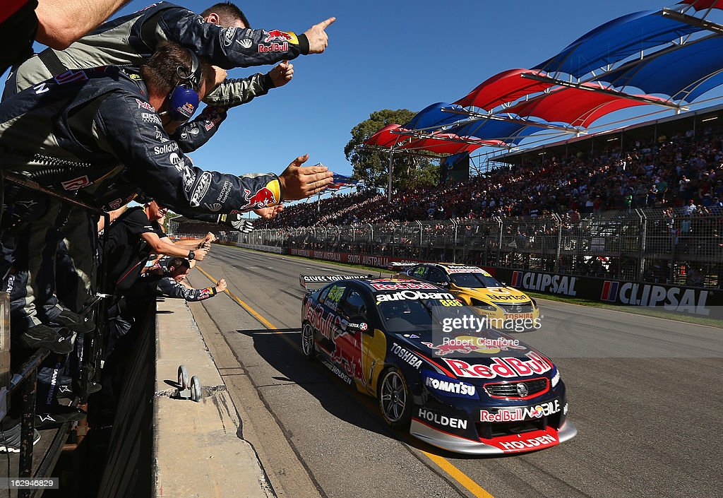 The Red Bull Racing Australia crew celebrate as Craig Lowndes driver of the #888 Red Bull Racing Australia Holden crosses the line to win race one of the Clipsal 500, which is round one of the V8 Supercar Championship Series, at the Adelaide Street Circuit on March 2, 2013 in Adelaide, Australia.
