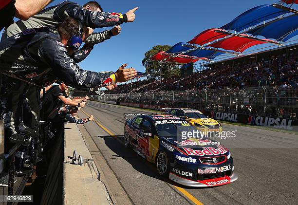The Red Bull Racing Australia crew celebrate as Craig Lowndes driver of the Red Bull Racing Australia Holden crosses the line to win race one of the...