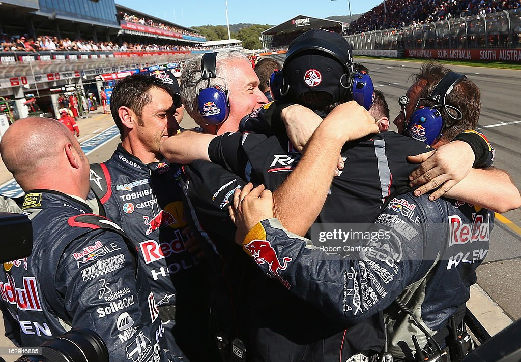 The Red Bull Racing Australia crew celebrate as <a gi-track='captionPersonalityLinkClicked' href=/galleries/search?phrase=Craig+Lowndes&family=editorial&specificpeople=213462 ng-click='$event.stopPropagation()'>Craig Lowndes</a> driver of the #888 Red Bull Racing Australia Holden crosses the line to win race one of the Clipsal 500, which is round one of the V8 Supercar Championship Series, at the Adelaide Street Circuit on March 2, 2013 in Adelaide, Australia.