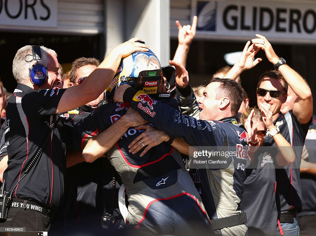 The Red Bull Racing Australia crew celebrate with <a gi-track='captionPersonalityLinkClicked' href=/galleries/search?phrase=Craig+Lowndes&family=editorial&specificpeople=213462 ng-click='$event.stopPropagation()'>Craig Lowndes</a> driver of the #888 Red Bull Racing Australia Holden after he won race one of the Clipsal 500, which is round one of the V8 Supercar Championship Series, at the Adelaide Street Circuit on March 2, 2013 in Adelaide, Australia.