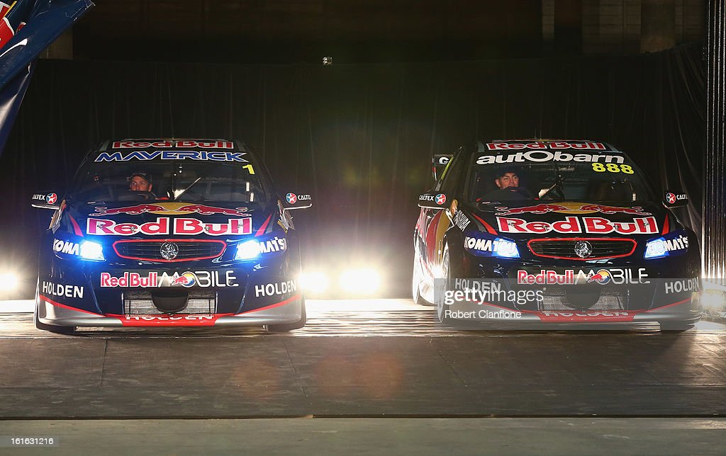 The Red Bull Racing cars of <a gi-track='captionPersonalityLinkClicked' href=/galleries/search?phrase=Jamie+Whincup&family=editorial&specificpeople=678654 ng-click='$event.stopPropagation()'>Jamie Whincup</a> and <a gi-track='captionPersonalityLinkClicked' href=/galleries/search?phrase=Craig+Lowndes&family=editorial&specificpeople=213462 ng-click='$event.stopPropagation()'>Craig Lowndes</a> are unveiled during the Red Bull Racing Australia 2013 V8 Supercars launch at Carriageworks on February 14, 2013 in Sydney, Australia.