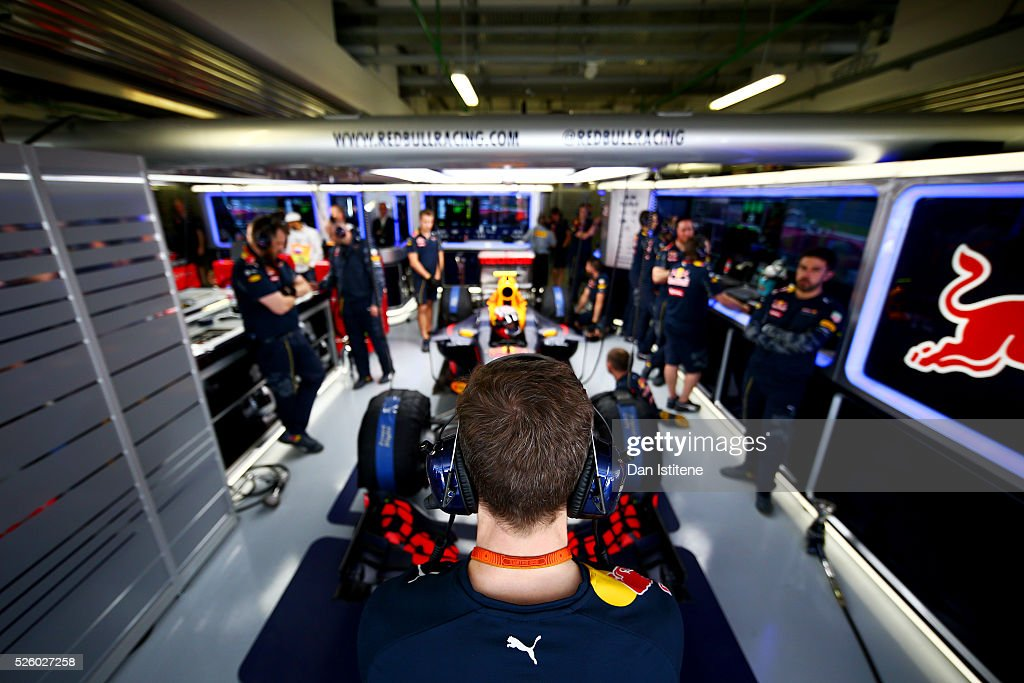 The Red Bull Racing team get ready in the garage during practice for the Formula One Grand Prix of Russia at Sochi Autodrom on April 29, 2016 in Sochi, Russia.