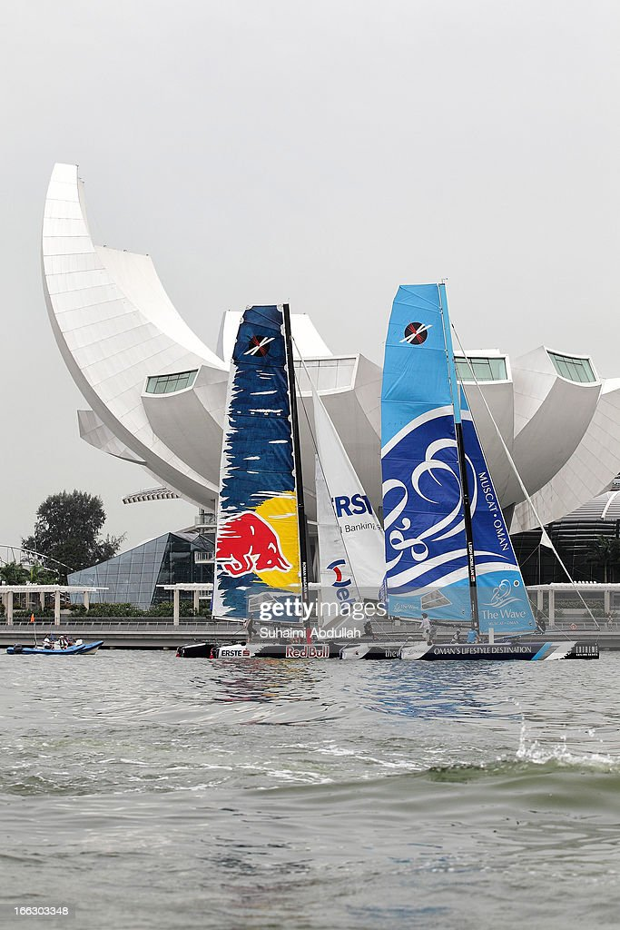 The Red Bull Sailing Team (L) and The Wave Muscat compete during day one of the Extreme Sailing Series at Marina Bay Reservoir on April 11, 2013 in Singapore.