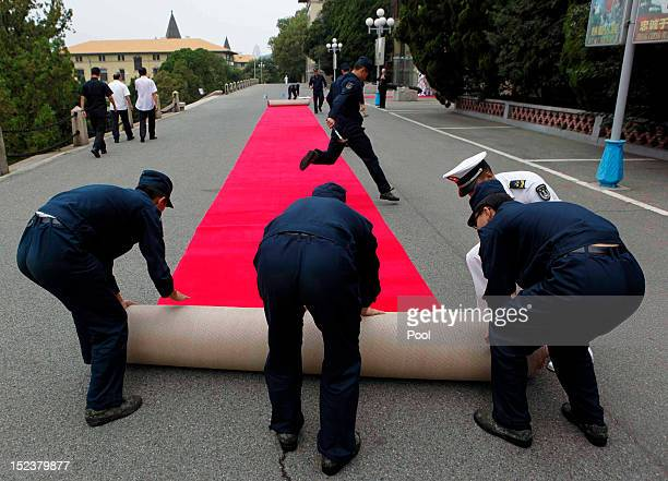 The red carpet is rolled up after US Secretary of Defense Leon Panetta reviewed a naval honor guard before touring Chinese naval vessels of the North...