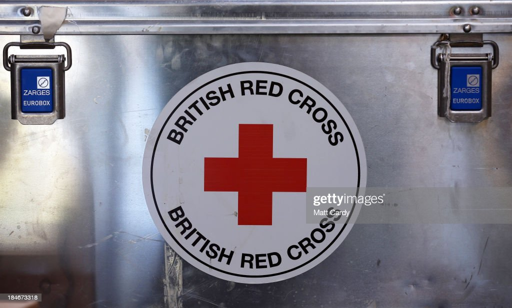 The Red Cross logo is displayed inside the British Red Cross Bristol Emergency Response Unit, as it marks the 150th anniversary of The Red Cross movement on October 15, 2013 in Bristol, England. The British Red Cross is currently celebrating the 25 million food parcels issued worldwide by the British Red Cross.