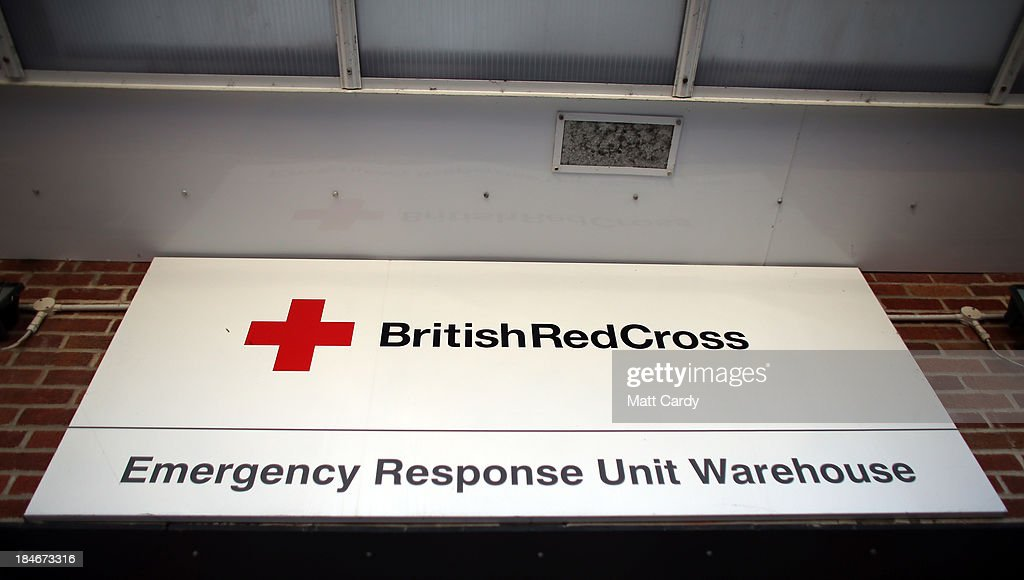 The Red Cross logo is displayed on a sign outside the British Red Cross Bristol Emergency Response Unit, as it marks the 150th anniversary of The Red Cross movement on October 15, 2013 in Bristol, England. The British Red Cross is currently celebrating the 25 million food parcels issued worldwide by the British Red Cross.