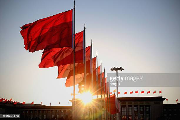 The red flags flutter in the wind outside the Great Hall of the People during the second plenary session of the Chinese People's Political...