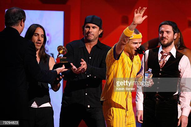 The Red Hot Chili Peppers Anthony Kiedis Chad Smith Flea and John Frusciantea accept the award for 'Best Rock Album' for Stadium Arcadium onstage at...