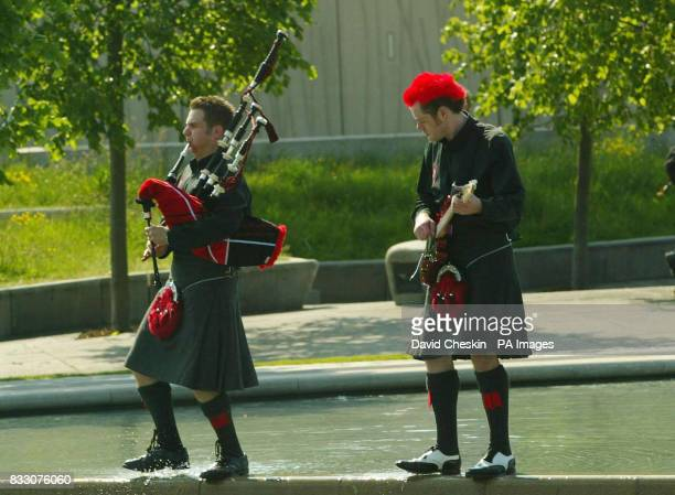 The Red Hot Chilli Pipers rehearse in the grounds of the Scottish Parliament in Edinburgh ahead of their performance at Picnic in the Parliament part...