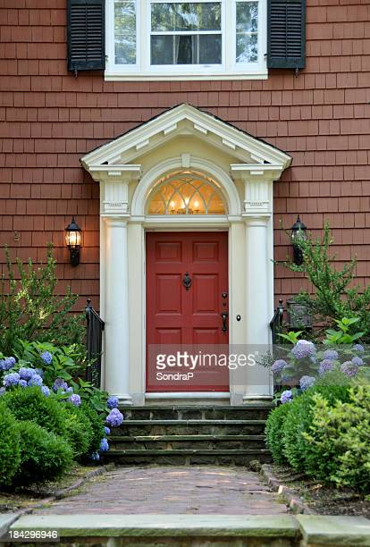 The red pillared door of a colonial design house