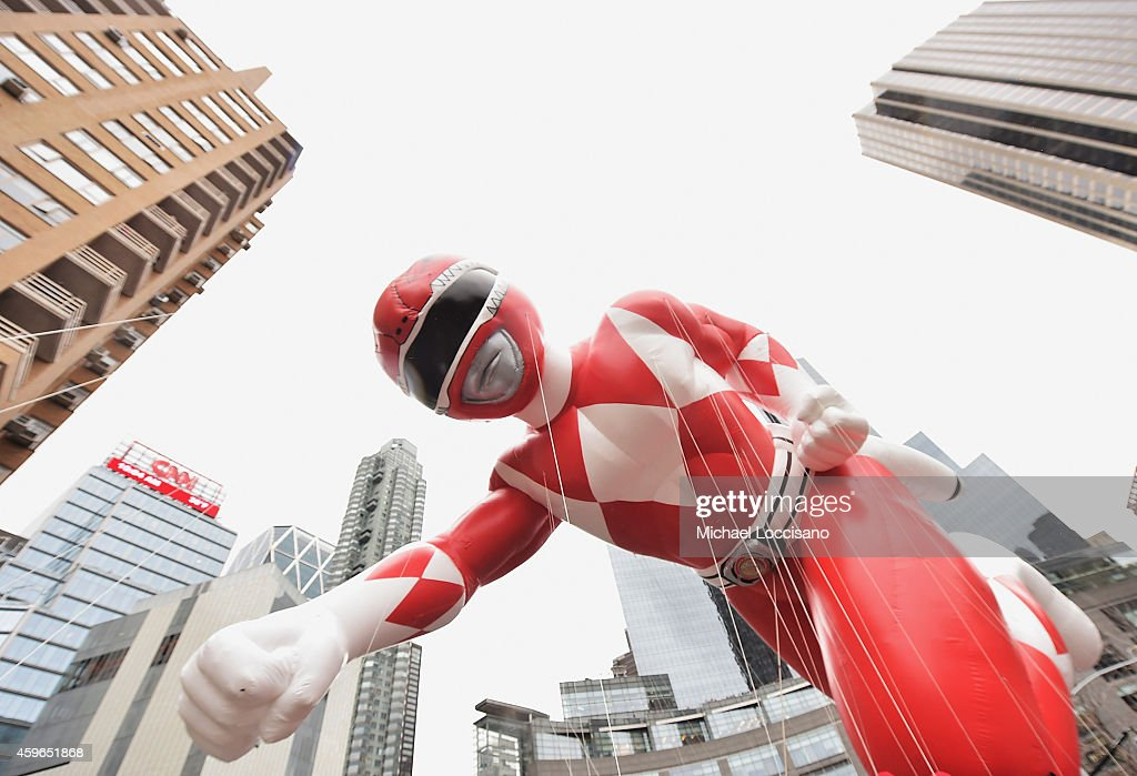 The red Power Ranger balloon passes by during the 88th annual Macy's Thanksgiving Day Parade on November 27 2014 in New York City Over 8000 people...