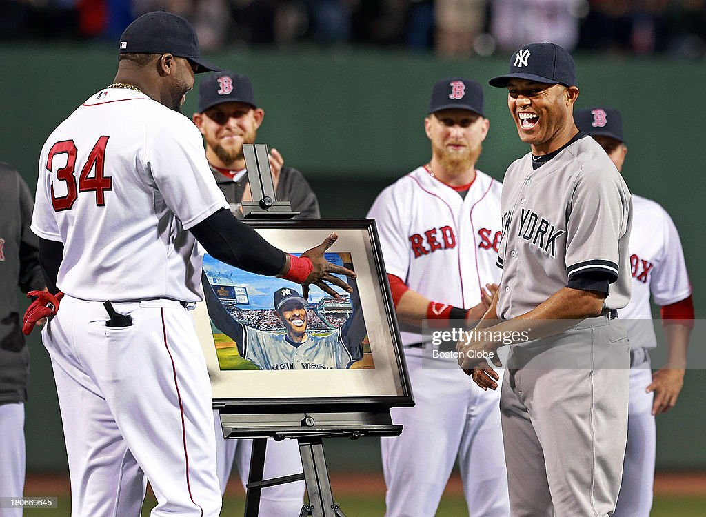 The Red Sox honored retiring Yankees closer Mariano Rivera in a pre-game ceremony held around the pitcher's mound. Here he is all smiles as Red Sox designated hitter David Ortiz presents him with a painting depicting his famous response to the ovation he received at Fenway Park on Opening Day in 2005. The Boston Red Sox hosted the New York Yankees in a regular season MLB game at Fenway Park.
