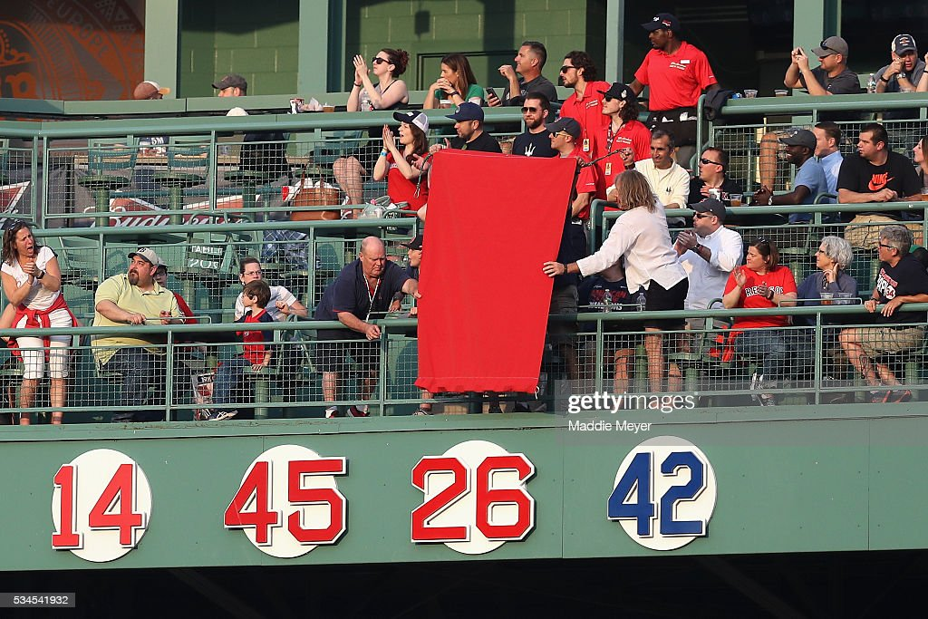 The Red Sox retire Wade Boggs' uniform number 26 prior to the game between the Boston Red Sox and the Colorado Rockies at Fenway Park on May 26, 2016 in Boston, Massachusetts.