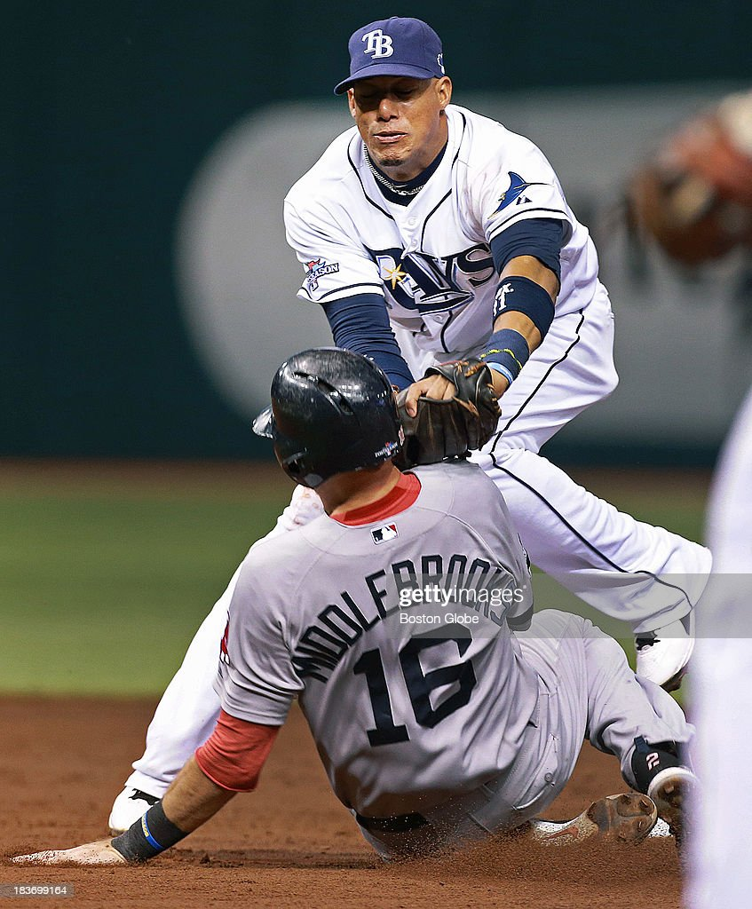 The Red Sox Will Middlebrooks is tagged out by Rays shortstop Yunel Escobar at the tail end of a 4-3-6 double play hit into by Jacoby Ellsbury in the top of the third inning. The Boston Red Sox visited the Tampa Bay Rays in Game Four of the ALDS baseball playoffs at Tropicana Field.