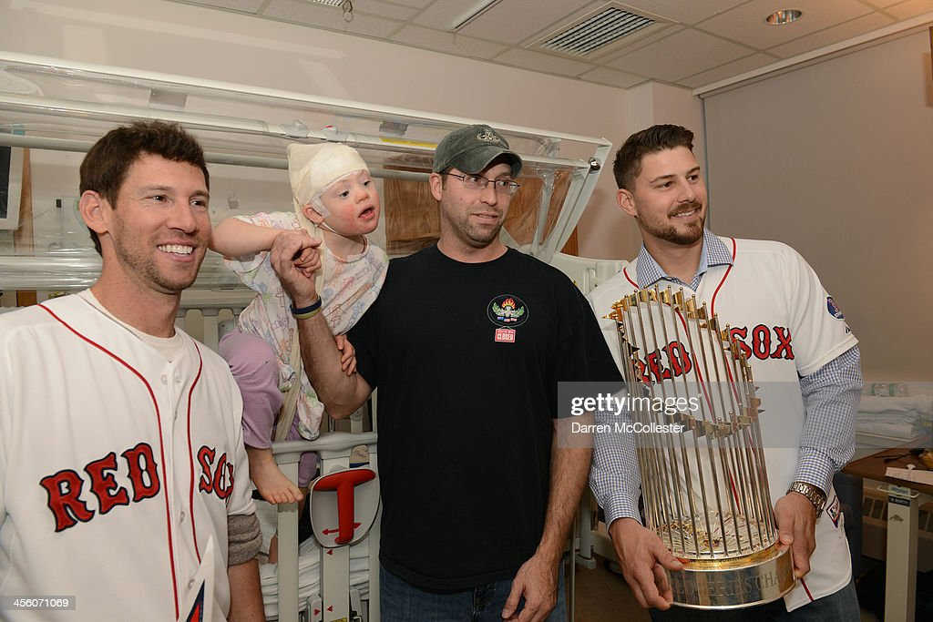 The Red Sox's Craig Breslow (L) and Ryan Lavarnway visit with Emily and Dad at Boston Children's Hospital on December 13, 2013 in Boston, Massachusetts.