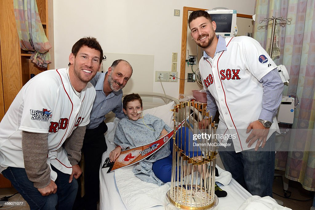 The Red Sox's Craig Breslow (L) and Ryan Lavarnway visit with Sam and Dad at Boston Children's Hospital on December 13, 2013 in Boston, Massachusetts.