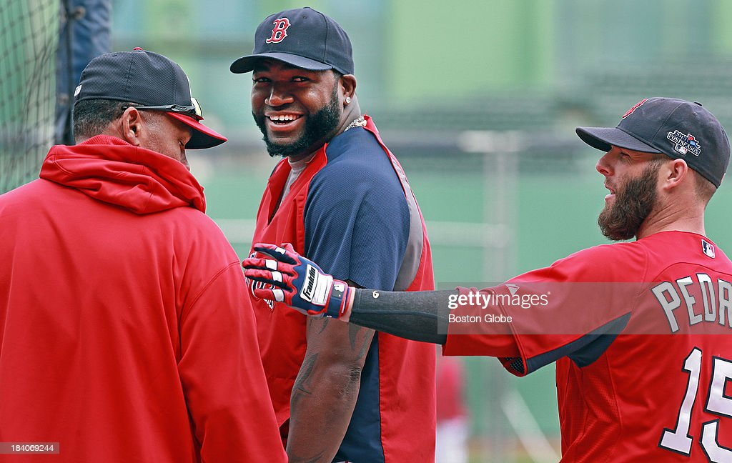 The Red Sox's David Ortiz (center) and Dustin Pedroia (right) have a laugh with staff coaching assistant Ino Guerrero (left) around the batting cage. The Boston Red Sox had a workout at Fenway Park in preparation for Game One of the ALCS against either Oakland or Detroit.