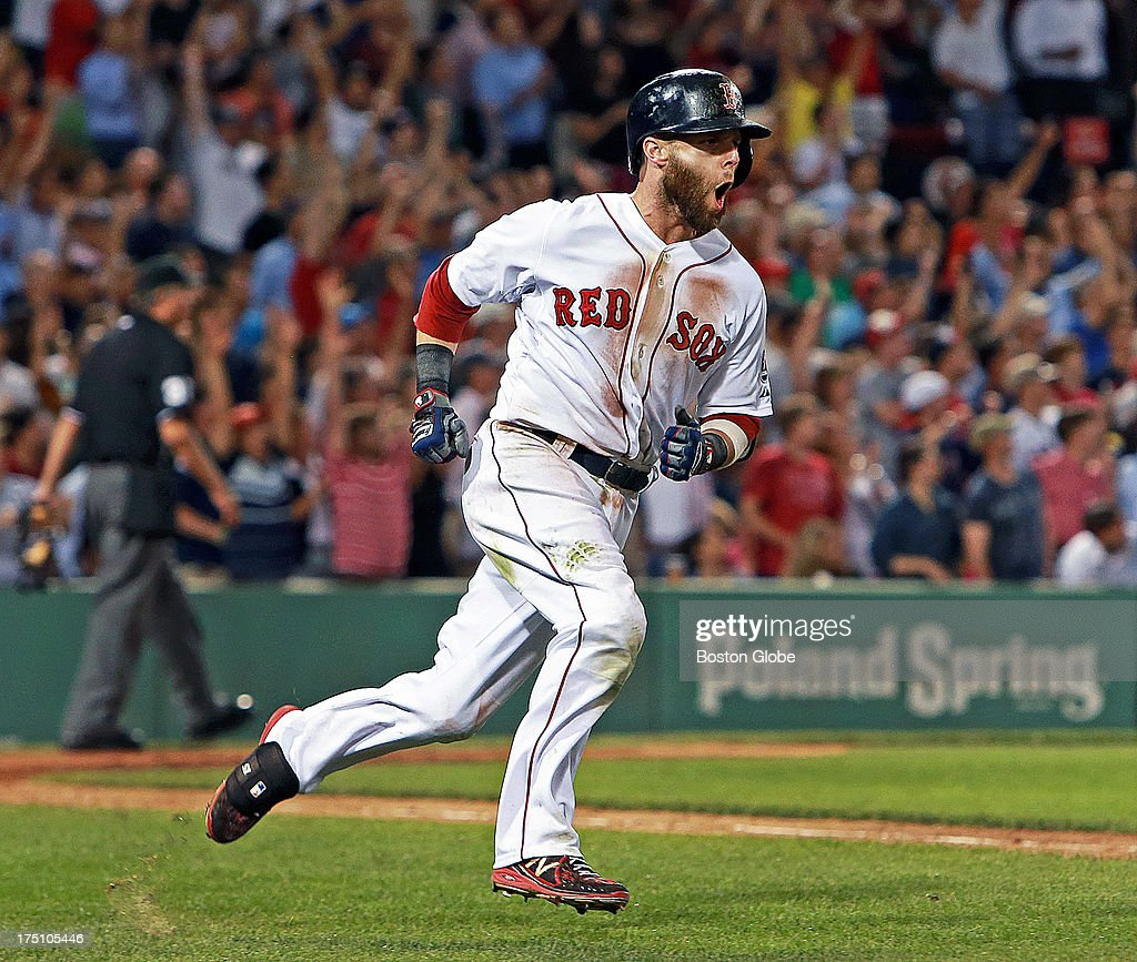 The Red Sox's Dustin Pedroia is walking on air as he howls in delight while heading down the first base line as his two-run seventh inning home run put Boston on top 4-3. The Boston Red Sox hosted the Seattle Mariners in an MLB regular season baseball game at Fenway Park.