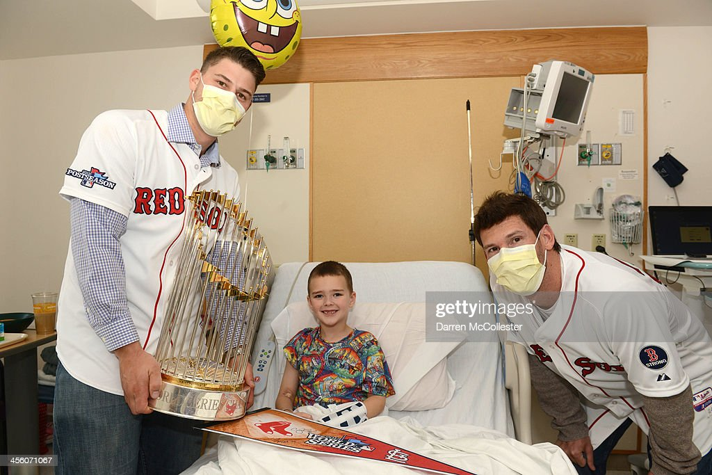 The Red Sox's Ryan Lavarnway (L) and <a gi-track='captionPersonalityLinkClicked' href=/galleries/search?phrase=Craig+Breslow&family=editorial&specificpeople=836367 ng-click='$event.stopPropagation()'>Craig Breslow</a> visit with Devon at Boston Children's Hospital on December 13, 2013 in Boston, Massachusetts.