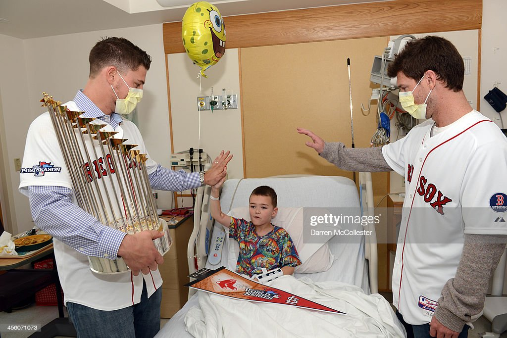 The Red Sox's Ryan Lavarnway (L) and Craig Breslow visit with Devon at Boston Children's Hospital on December 13, 2013 in Boston, Massachusetts.