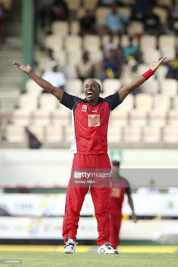 The Red Steel captain Dwayne Bravo celebrates after getting the wicket of St. Lucia Zouks captain Darren Sammy (not in frame) during a match between St. Lucia Zouks and The Trinidad and Tobago Red Steel as part of week 4 of the Limacol Caribbean Premier League 2014 at Beausejour Stadium on August 02, 2014 in Castries, St. Lucia.