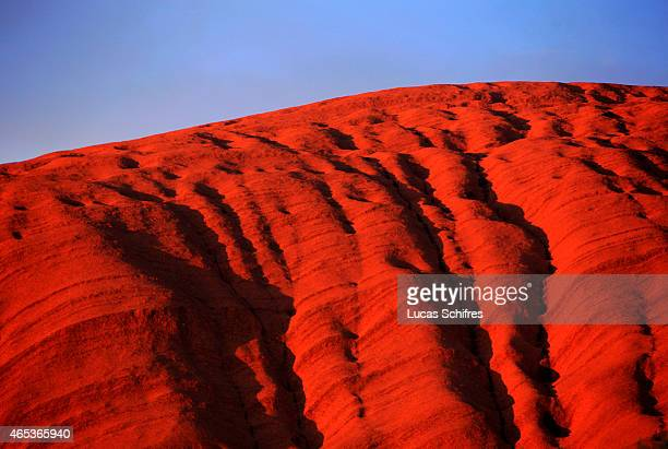 The red stone of Ayers Rock or Uluru at dawn on December 30 2008 in Northern Territory Australia